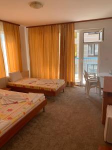 Кровать или кровати в номере Lilia Guest House