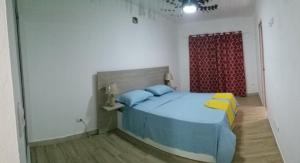 A bed or beds in a room at Agua del Caribe