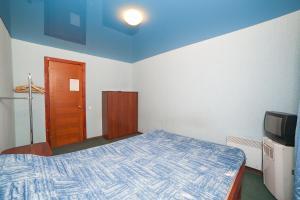 Кровать или кровати в номере Guest House Ekotel
