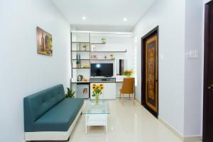 A television and/or entertainment centre at CBD Home - Home in Central - The Art