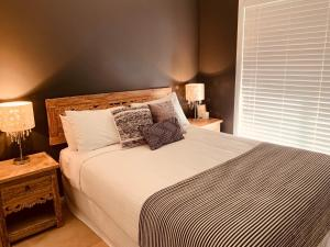 A bed or beds in a room at Bella Farm Country House Hunter Valley