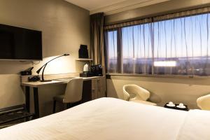 Een bed of bedden in een kamer bij Riva hotel Den Haag - Delft