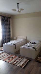 Un pat sau paturi într-o cameră la Agropensiunea Izana