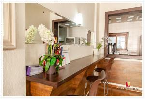 A kitchen or kitchenette at Bandeira Hotel