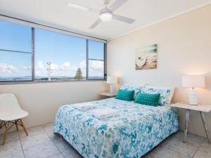 A bed or beds in a room at Oceanic 26