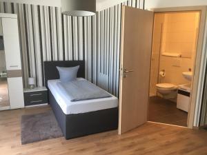 Ein Badezimmer in der Unterkunft Pension Sonntag Ferienwohnungen