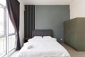 Katil atau katil-katil dalam bilik di DreamScape Apartment @ Golden Hill