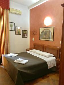 Letto o letti in una camera di Hotel Edy