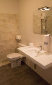 Salle de bains dans l'établissement Adonis Ajaccio - Hôtel Albion