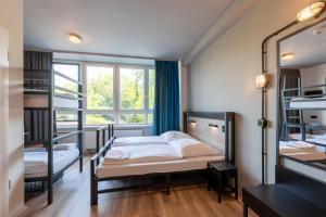 A bed or beds in a room at a&o Hamburg City
