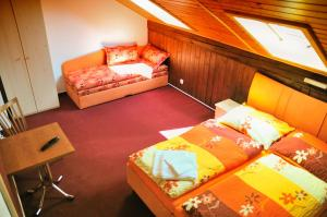A bed or beds in a room at Penzion Kameňák