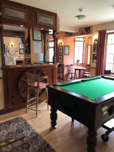 A billiards table at The Old Stables