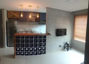 A television and/or entertainment center at Conforto - VOG Torres do Sul Ilhéus