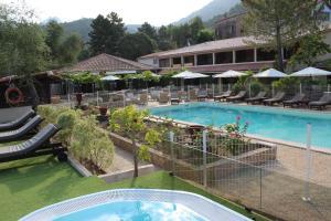 The swimming pool at or near Domaine de l'Oriu
