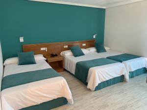 A bed or beds in a room at Nueva Colina