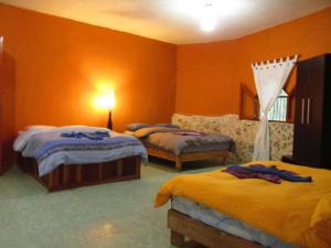 Кровать или кровати в номере Organic Yoga Mexico