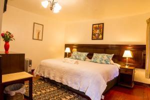 Cama o camas de una habitación en Gringo Bill's Cusco