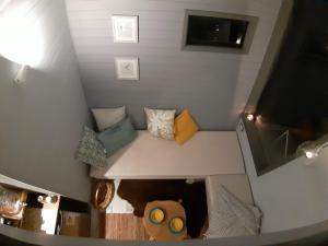 Una cama o camas en una habitación de TREE LODGE CHILOE