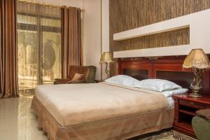 Кровать или кровати в номере Славянская Ладья