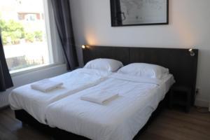 Un ou plusieurs lits dans un hébergement de l'établissement Jordans Residence