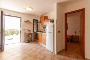 A kitchen or kitchenette at Apartments Loretta with Sea View