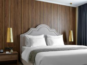 A bed or beds in a room at Boutique Hotel 39