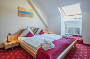 Ein Bett oder Betten in einem Zimmer der Unterkunft Mühlenthalers Park Hotel