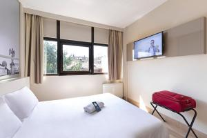 A bed or beds in a room at B&B Hotel Udine