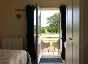 A bed or beds in a room at Moorhouse Farm Flat