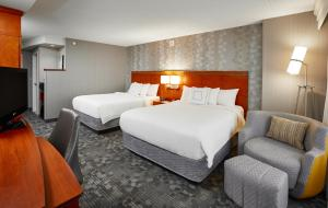 A bed or beds in a room at Courtyard by Marriott Toronto Brampton