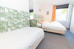 Een bed of bedden in een kamer bij Hotel het Anker