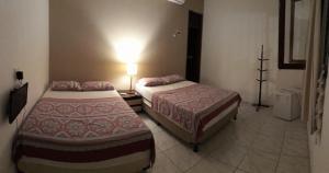 Cama ou camas em um quarto em Pousada Amaina Natal