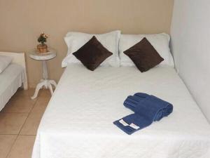 Cama ou camas em um quarto em Aloha Beach Temporada