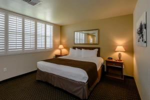 A bed or beds in a room at Lions Gate Hotel Trademark Collection by Wyndham