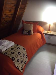 Una cama o camas en una habitación de Hostería Antu Kuyen