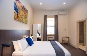 A bed or beds in a room at The Mile End Hotel