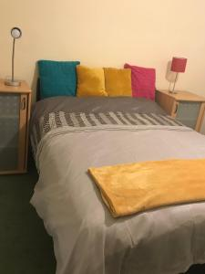 A bed or beds in a room at Spare room