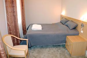 Кровать или кровати в номере Резидент Отель