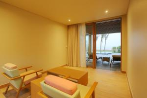 A seating area at FLC Luxury Hotel Samson