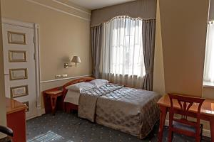 A bed or beds in a room at Europe Hotel