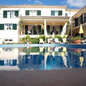 The swimming pool at or near Vila De Sol