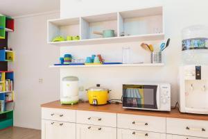 A kitchen or kitchenette at Wonderful Land B&B