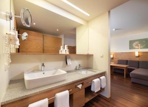 Ein Badezimmer in der Unterkunft Familotel Schreinerhof