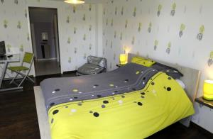 A bed or beds in a room at LA CLER'HIER