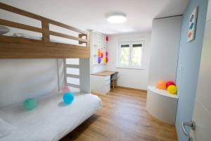 A bunk bed or bunk beds in a room at Apartment NAUTA LUX