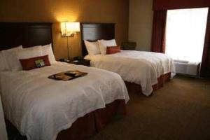 A bed or beds in a room at Hampton Inn & Suites Lanett/West Point