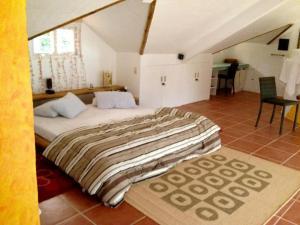 A bed or beds in a room at Kokays Maldito Dive Resort