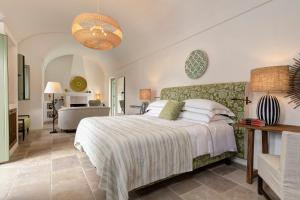A bed or beds in a room at Rocco Forte Masseria Torre Maizza