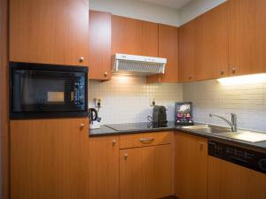 A kitchen or kitchenette at Marriott Executive Apartments Brussels