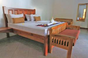A bed or beds in a room at Jo Je Bungalow